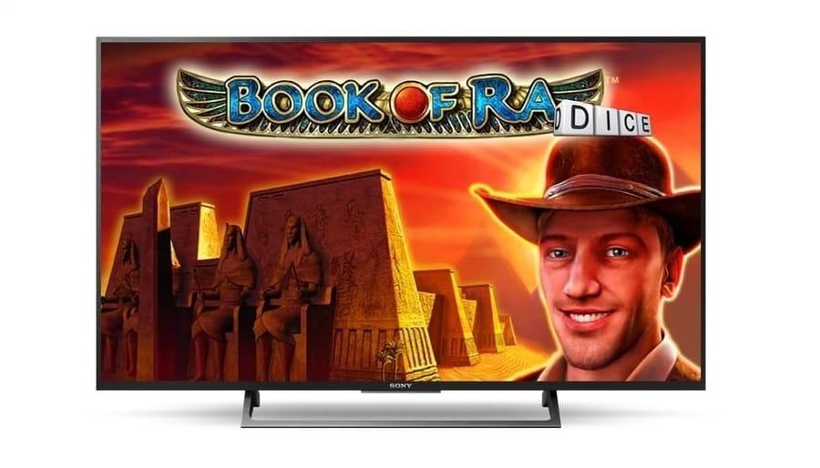 Una schermata con il logo del gioco Book of Ra dice e lo sfondo su un paesaggio egiziano. I colori prevalenti sono rosso, arancion e giallo.